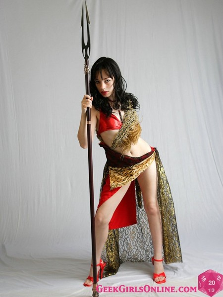 Naked Geek Girl Starla shows off her Medieval weapon collection